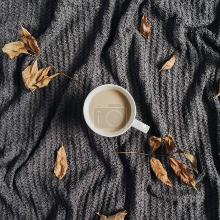 Coffee with milk on warm terry plaid