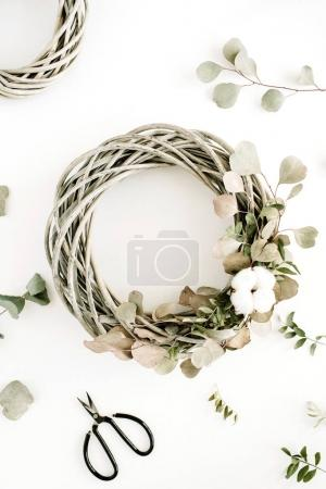 Wreath frame with cotton balls and eucalyptus branches