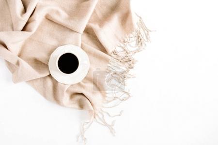 coffee on beige plaid