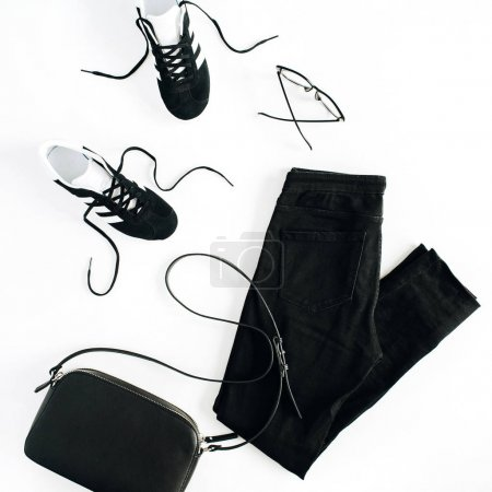 Trendy fashion black styled woman clothes and accessories look on white. Flat lay, top view.