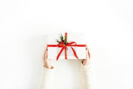 Women hands holding gift box