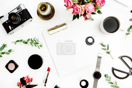 Photo for Female home office workspace with clipboard, laptop, rose flowers, eucalyptus branches, fashion accessories and cosmetics. Flat lay, top view fashion mockup this space for text. - Royalty Free Image