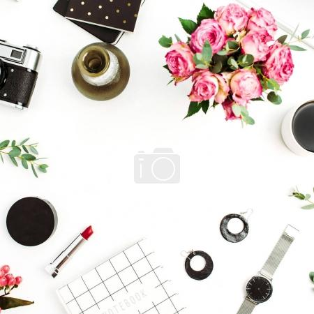 Photo for Frame made of fashion accessories, cosmetics, rose flowers, photo camera, notebook on white background. Flat lay, top view female blog or website mockup. - Royalty Free Image