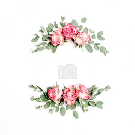 Floral frame wreath made of red rose flower buds on white background. Flat lay, top view blog hero header mockup.