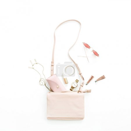 Photo for Woman fashion trendy accessories set: purse, sunglasses, watch, bracelet, necklace, lipstick, earrings on white background. Flat lay, top view stylish pastel pink concept. - Royalty Free Image