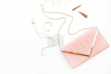 Female fashion trendy stylish pastel pink accessories set on white background. Flat lay, top view.