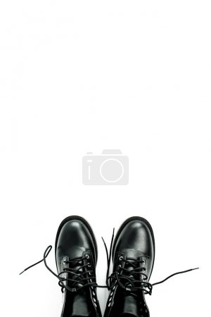 Photo for Woman fashion flat lay, top view minimal concept. Black shoes on white background. - Royalty Free Image