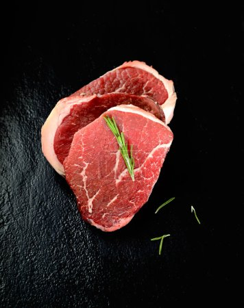 raw beef steak marble on a black background