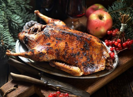 Grilled duck with apples on a plate
