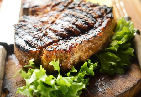 Grilled steak on a cutting board.
