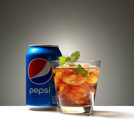 Can and glass of PepsiCola