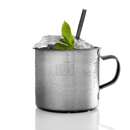 Drink with leaves of mint in the metal mug