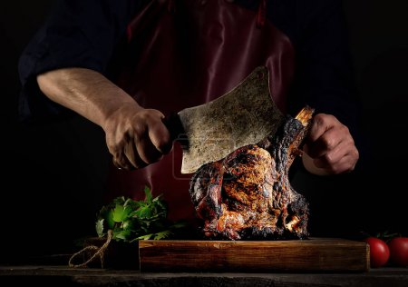 Man cutting  grilled beef