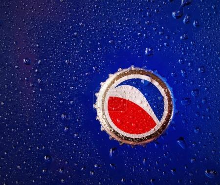 Pepsi cap on a blue