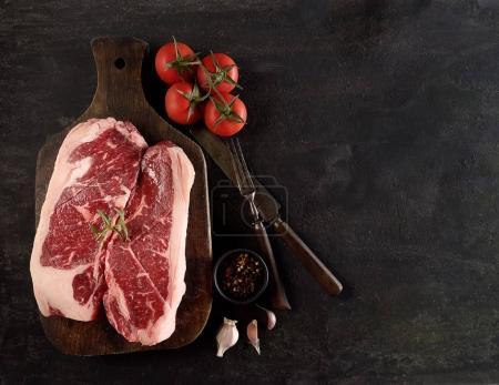 raw beef marble steaks