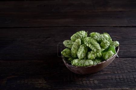 wooden bowl full of hop cones