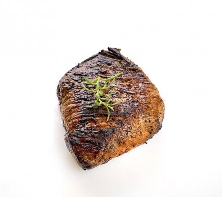 grilled juicy steak with rosemary isolated on white