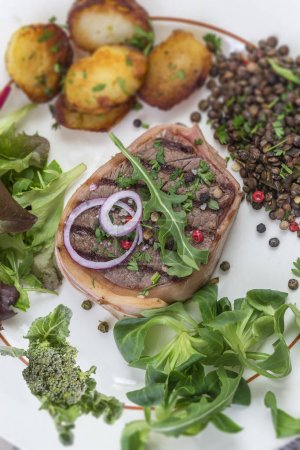 Photo for Beef tournedos and roquefort sauce with roasted tomatoes - Royalty Free Image