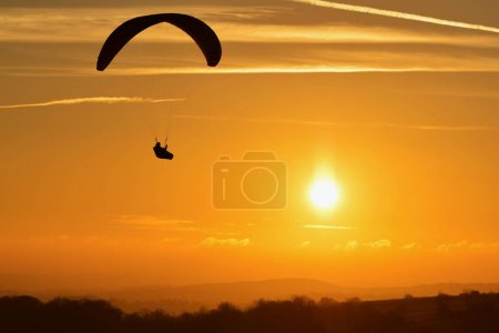 Paraglider flying in Evening Sky