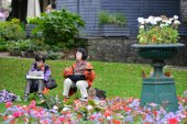 Japanese tourists painting town scenery
