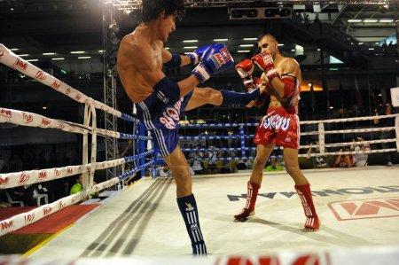 BANGKOK, Thailand - Nvember 21, 2012: brave men fighting at amateur Thai kickboxing.