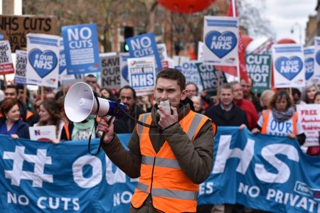 London, UK - March 4, 2017: Protesters marching through central London during demonstration in support of NHS