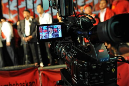 Bangkok, Thailand - Jan 29, 2013: Thai Prime Ministers deputy seen through electronic viewfinder of video camera