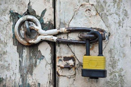 Closeup view of old locked door