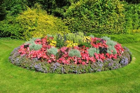 Photo for Decorated innocent garden with bright green plants and colourful flowers - Royalty Free Image