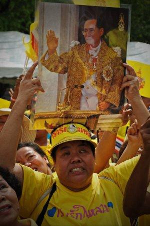 BANGKOK - December, 5: woman holding portrait of Thai King Bhumibol Adulyadej after attending celebrations of King 85th birthday