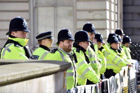 policemen in uniform in row at street