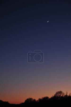 Landscape with majestic deep dark sky and orange sunset