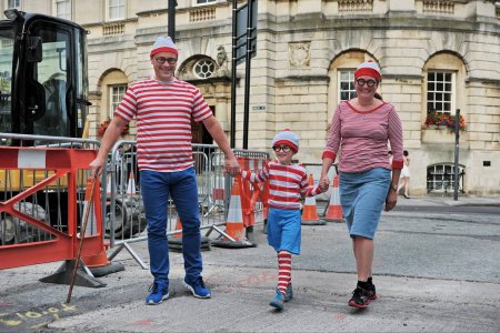 Bath, UK - September 28, 2012: family dress up as fictional character Wally from British puzzle book series by author and illustrator Martin Handford.