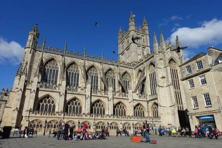 Bath, UK - May 9, 2018: Tourists and locals gathering in courtyard of Bath Abbey.