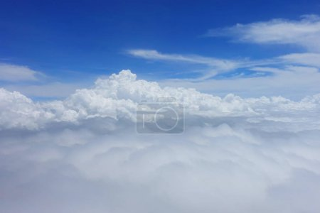 Blue sky with fluffy white clouds in daytime