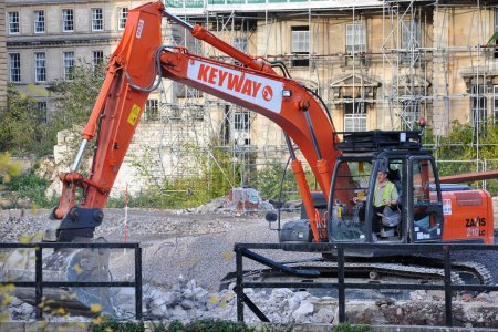 Photo for BRADFORD ON AVON - OCT 27: A excavator works on a construction site in the town center on Oct 27, 2009 in Bradford on Avon, UK. The historic Wiltshire town is undergoing redevelopment. - Royalty Free Image
