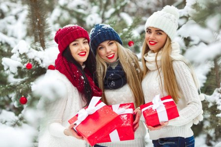 Group of beautiful winter girlfriends laughing