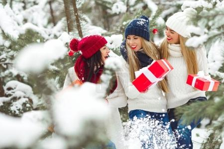 Group of beautiful winter girlfriends laughing