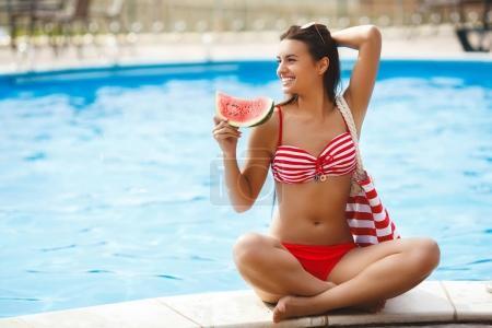 Pretty woman near the swimming pool