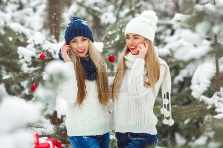 Beautiful girlfriends on the winter background