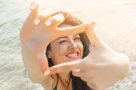 Young attractive woman making selfie at the beach