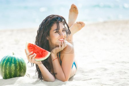 Photo for Young attractive woman on the beach relaxing. Pretty woman with watermelon. Cute girl outdoors - Royalty Free Image