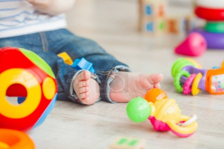 Unrecognazable child plaing with colorful toys