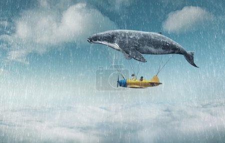 Photo pour Emmène-moi au concept du rêve. Deux mignonnes petites filles asiatiques assises dans un avion vintage, s'accrochant à une grosse baleine grise et survolant les nuages sous la pluie - image libre de droit