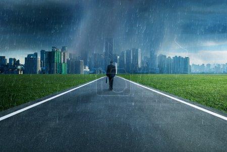 Business man facing a storm