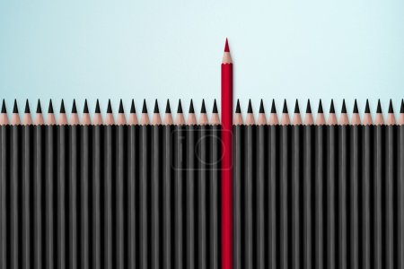 Red pencil standing out from black