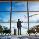 Young businessman waving good bye at airport...