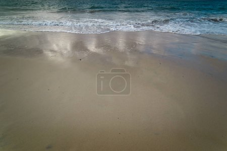 Soft Wave On Sandy Beach