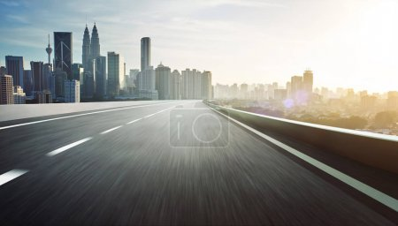 Photo for Highway overpass motion blur with city skyline background . Sunset scene . - Royalty Free Image