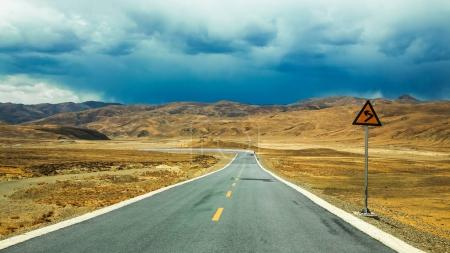 Asphalt road in desert